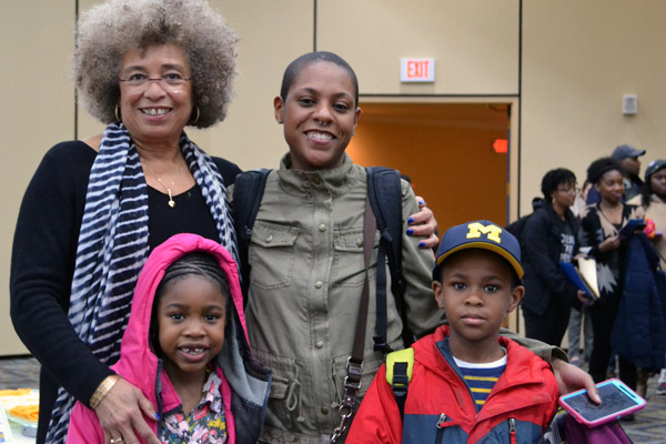 Angela Davis with social work major Kristen Twitty and her children