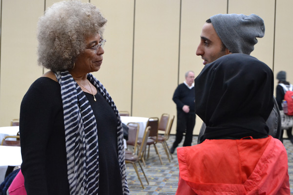 Angela Davis speaks with students after her final UM-Flint forum