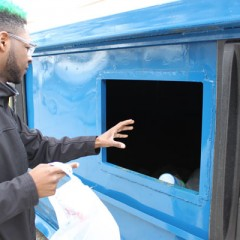 UM-Flint Theatre student Sandrese Green pitches in to help with the recycling challenges.