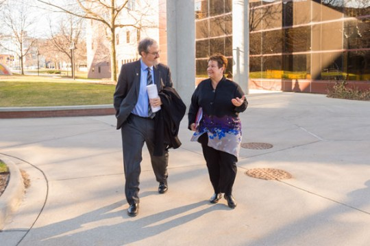 U-M President Mark Schlissel talking with UM-Flint Chancellor Susan E. Borrego on the Flint campus Monday, March 21, 2016.