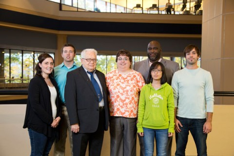 Emeritus Professor of Accounting Walker E. Fesmire with UM-Flint students and others helping out with tax assistance program.