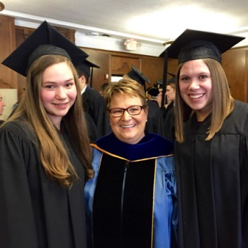 UM-Flint James B. Angell Scholars Elena Sobrino and Rebecca DeJonge with Chancellor Susan E.</body></html>