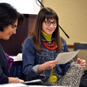 Shelby Newport of Theatre & Dance and Amy York of Physical Therapy discuss peer observation at the 2016 UM-Flint Celebration of Teaching.