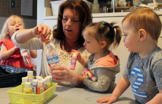 ECDC children help create chandelier.