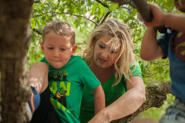 Mary Lynn Gottler and youngsters at UM-Flint's ECDC explore nearby nature.