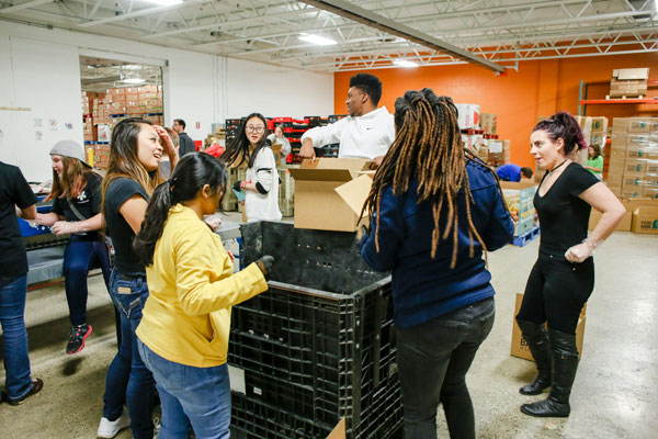 UM-Flint students learn to apply knowledge in real-world contexts, such as this Food Bank of Eastern Michigan distribution center.