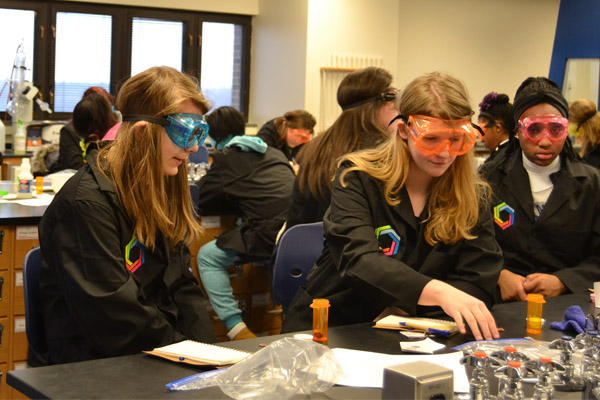Curiosity Academy students conduct an experiment in a UM-Flint lab