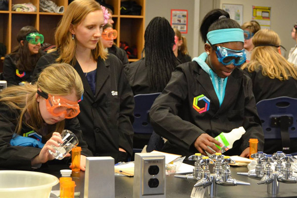 Samantha Grathoff works with students in a Curiosity Academy session at UM-Flint