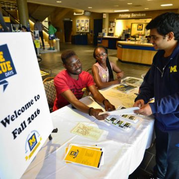 Info desk in the UCEN lobby during first day of Fall 2016 classes
