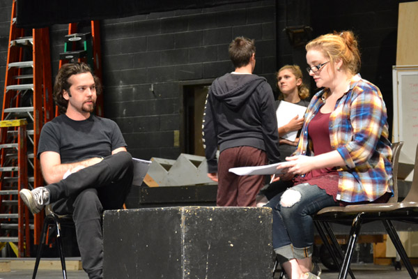 "Shelby Coleman, far right, rehearses a scene on the early set of ""Next to Normal"""