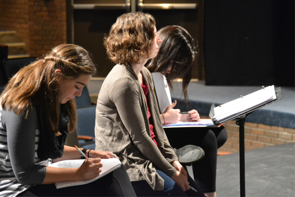 Stephanie Dean sits with Assistant Director Michaela Nogaj and Stage Manager Taylor Boes during rehearsal