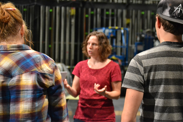"""UM-Flint Theatre's Stephanie Dean talks with student cast members during a rehearsal of """"Next to Normal."""""""