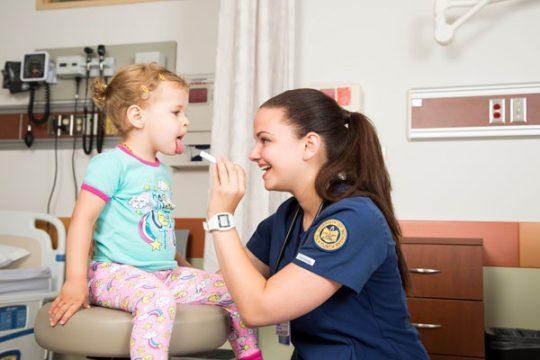 UM-Flint nursing student with young patient.