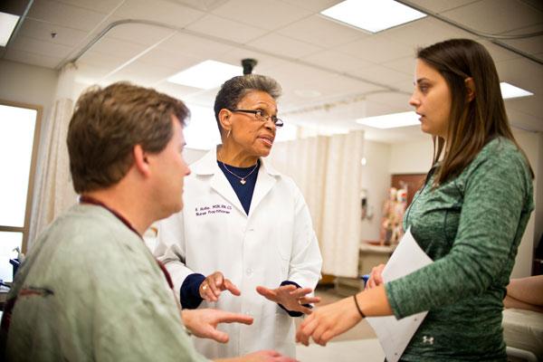 UM-Flint nursing faculty member Barbara Hollie, PhD, MSN, ANP-BC with students.