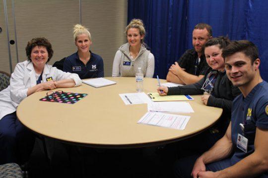 Participants in UM-Flint's interdisciplinary health care simulation
