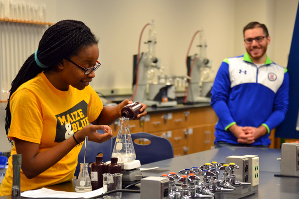 Lynnette Harris and Noor Alawwa of the UM-Flint Chem Club conduct a demo for visiting high schoolers.