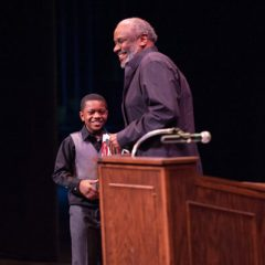 Eric Lynn, winner of the district-wide fourth grade spelling bee at Flint Community Schools, introduced Mr. Curtis in the morning session.