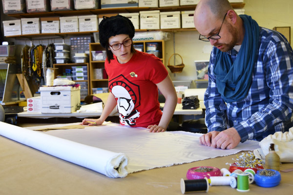 Adam Dill of UM-Flint Theatre working with a student in the university's Costume Shop