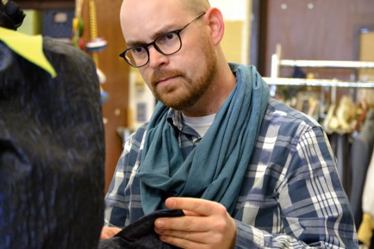 Adam Dill of UM-Flint Theatre working in the university's Costume Shop