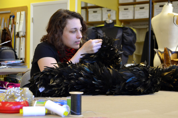 "Taylor Boes works on a boa for ""The Importance of Being Earnest."" She's also an actress in the production."