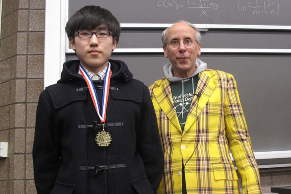 "A 2015 Math Field Day participant and UM-Flint professor of mathematics Kenneth Schilling, sporting the ""yellow jacket."""
