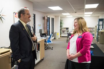 Sara McDonnell speaking with President Schlissel about the MapFlint project
