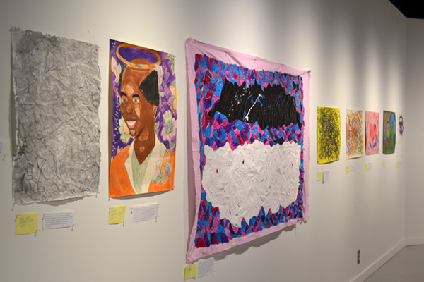 Flint Community Schools student pieces hanging in the UM-Flint Art Gallery