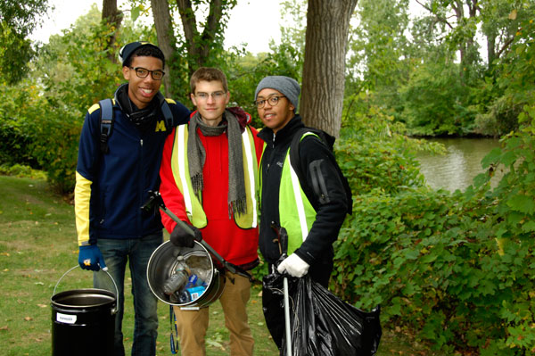 Zach Hayes (center) will fellow FUEL members at a Flint River cleanup.