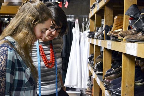 UM-Flint Theatre student Sarah Briggs and Department Chair Shelby Newport collect design pieces for the upcoming production