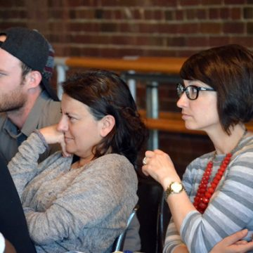 UM-Flint Theatre student Seth Barnes (left) and Department Chair Shelby Newport (right) sit at rehearsal with the production's director, Purni Morell of London's Unicorn Theatre