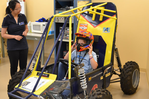A GEMS participant sits in UM-Flint engineering's Baja Racer