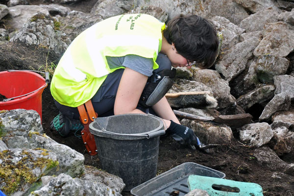 UM-Flint anthropology student Erin Sack searching for relics at the Caherconnell Field School in Ireland