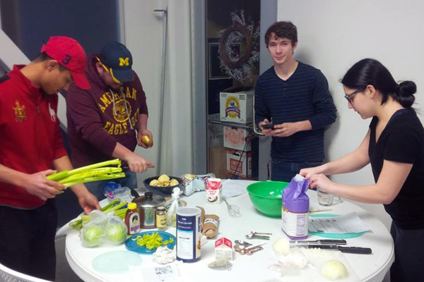 Students preparing a meal for their final exam in UNV 100: Food and Culture