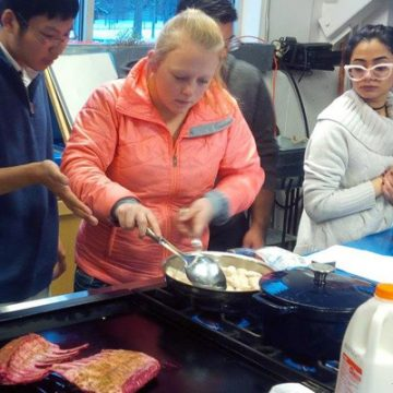 Students in UNV 100: Food and Culture prepare a meal for their final exam