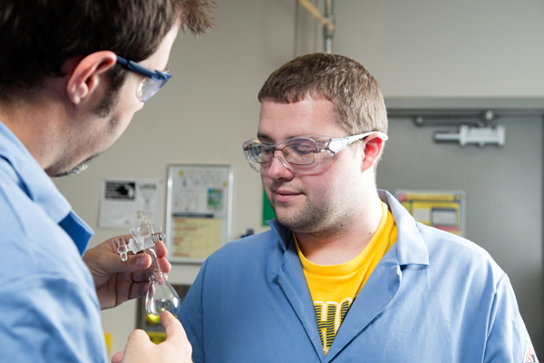Associate Professor Nick Kingsley (left) working with Tyler Doyon (right) in a UM-Flint Chemistry lab