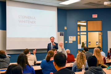 Alumnus Stephen A. Whitener speaks to UM-Flint business students