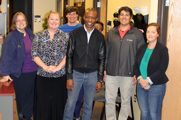 Adedotun Ojelabi with UM-Flint International Center colleagues.
