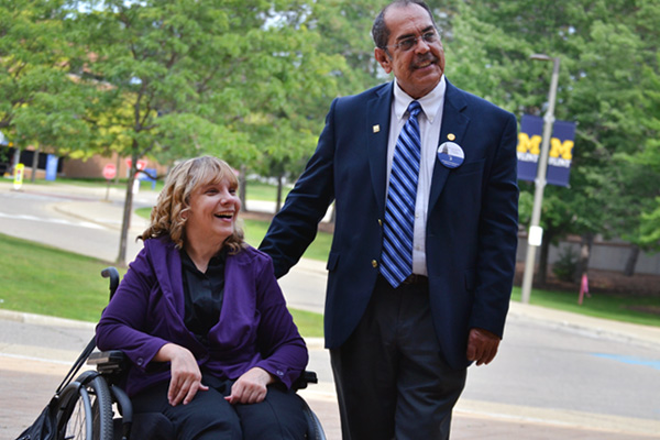 Charlene Lizotte (left) stands with State Representative Tim Sneller (right) on the UM-Flint campus