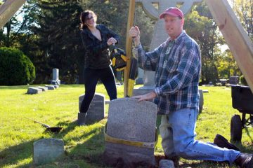 UM-Flint History professor Thomas Henthorn and students at Old Calvary Catholic Cemetery.