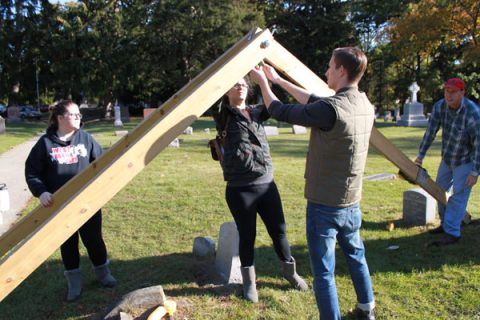 Students set up equipment that will allow them to do headstone preservation work.