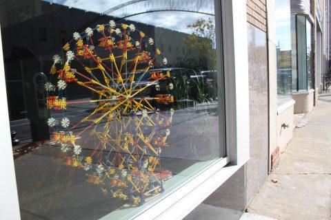 A model ferris wheel in the window of the Ferris Wheel Building.