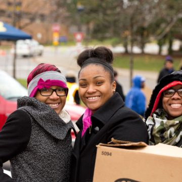 UM-Flint students volunteer at annual Holiday Food Giveaway.