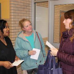 Shearese Stapleton and Vicki Cantrell are greeted by UM-Flint Staff Council member Melissa Richardson.
