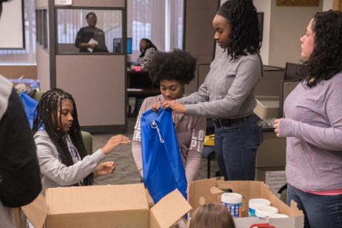 MLK Day volunteers assemble care packages for area homeless.