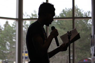 A UM-Flint student performs at an open mic event on campus.