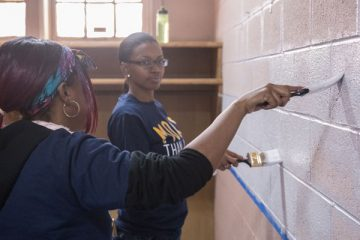 Student volunteers painting at Joy Tabernacle in Flint.