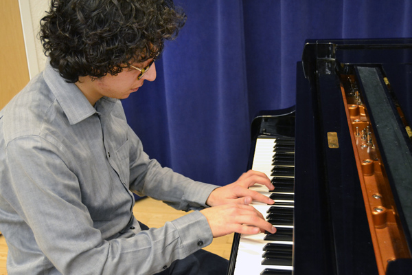 Antonio Caballero plays in the UM-Flint Music recital hall.