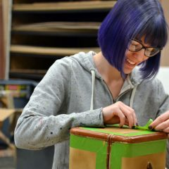 "Scenic Designer Lisa Borton works on props for the UM-Flint Theatre production of ""Lend Me a Tenor."" She also worked as costume designer for this production."