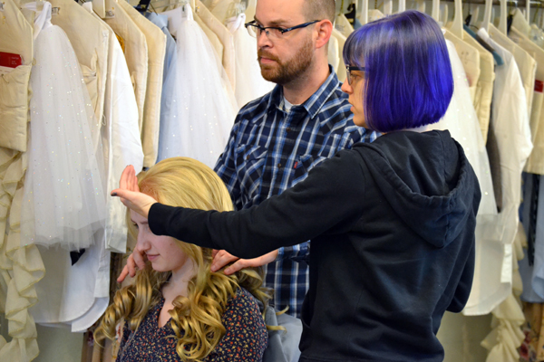 Lisa Borton discusses styling decisions with Costume Shop Supervisor Adam Dill.