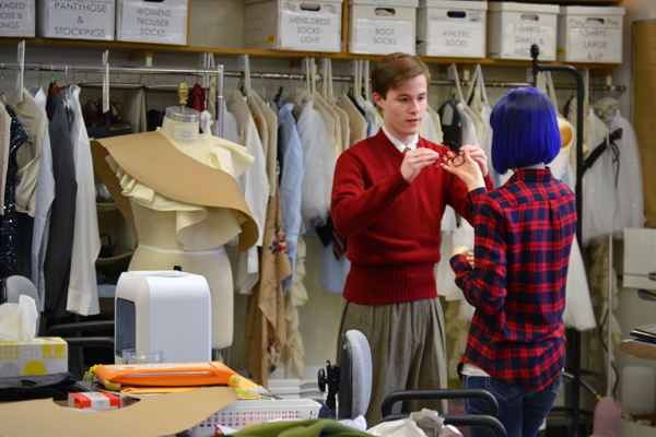 Lisa Borton and student Paul Gregor in the UM-Flint Theatre Costume Shop preparing for a publicity photo shoot.